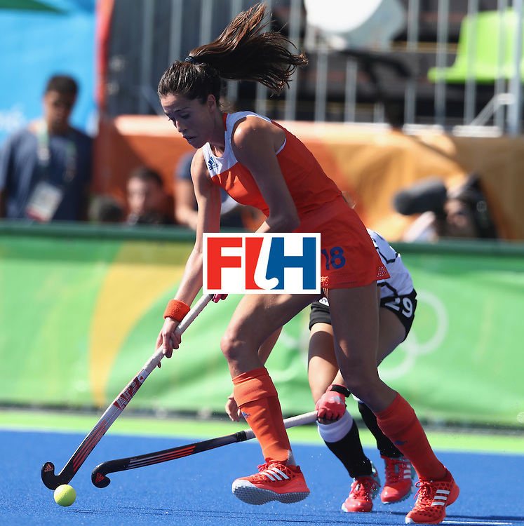 RIO DE JANEIRO, BRAZIL - AUGUST 13:  Naomi van As of the Netherlands moves away with the ball during the Women's group A hockey match between the Netherlands and Germany on Day 8 of the Rio 2016 Olympic Games at the Olympic Hockey Centre on August 13, 2016 in Rio de Janeiro, Brazil.  (Photo by David Rogers/Getty Images)