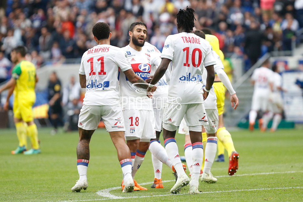 Fekir Nabil of Lyon and Depay Memphis of Lyon and Traore Bertrand of Lyon during the French Championship Ligue 1 football match between Olympique Lyonnais and FC Nantes on April 28, 2018 at Groupama Stadium in Décines-Charpieu near Lyon, France - Photo Romain Biard / Isports / ProSportsImages / DPPI