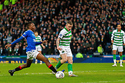 Joe Aribo of Rangers FC stops Jonny Hayes of Celtic FC getting to the ball during the Betfred Scottish League Cup Final match between Rangers and Celtic at Hampden Park, Glasgow, United Kingdom on 8 December 2019.