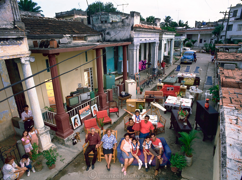 The Costa Family outside their home with all of their possessions, Havana, Cuba. Published in the book Material World, pages 106-107. From Peter Menzel's Material World Project that showed 30 statistically average families in 30 countries with all their possessions.