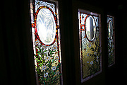 San Jose California USA, stained glass windows in the Interior of the winchester mystery house a Victorian mansion, designed and built Sarah L. Winchester construction began in 1884