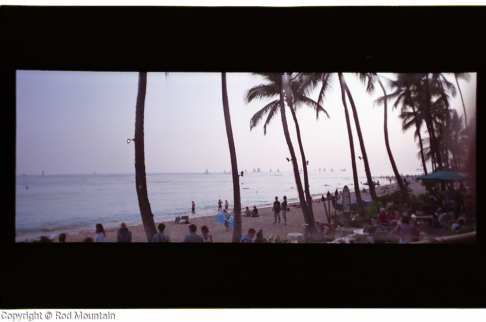 "A Hawaii beach scene taken with a lomography film camera in 4 x 11"" aspect ratio."