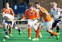 ROTTERDAM -    Pepijn Reijenga,  Nick Doeser , with Adam Buckle (l) and Finley Newton.    Practice Match  Hockey : Netherlands Boys U16  v England U16 . COPYRIGHT KOEN SUYK