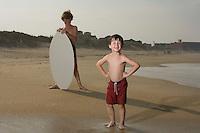 Portrait of boys on sandy beach