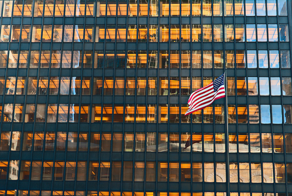 United States flag flying in front of office tower, Midtown Manhattan, New York, US