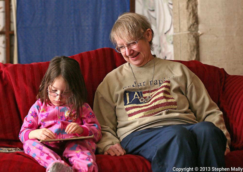 Cathy Faulkner (right) watches as her granddaughter, Kayleigh Faulkner, 4, works on a puzzle at her house in Cedar Rapids on Wednesday, February 27 2013.