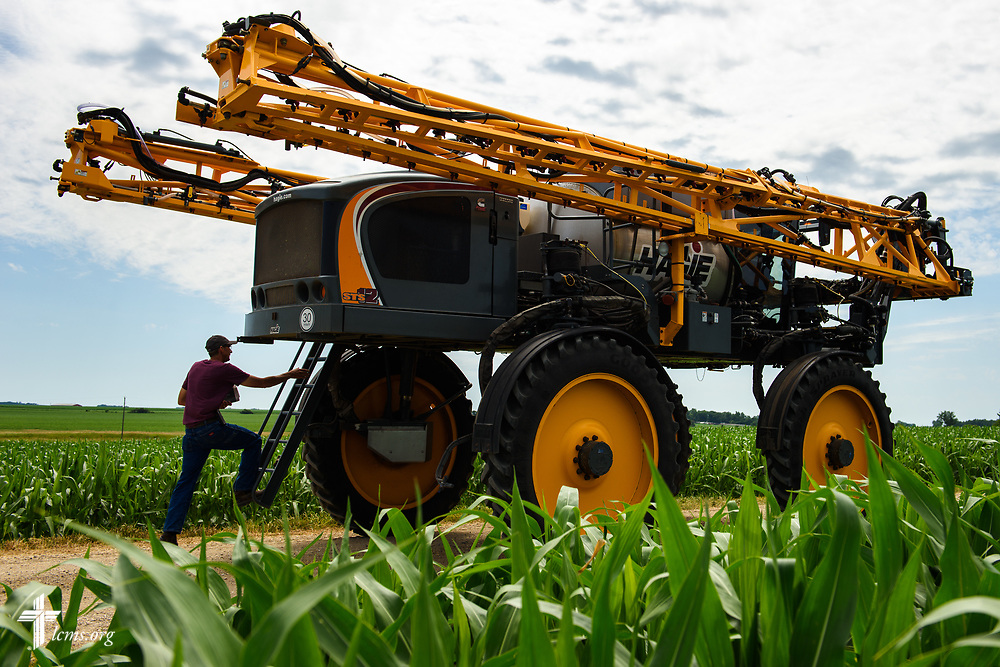 The Rev. Steven Struecker, full-time farmer and pastor of <br /> Immanuel Lutheran Church, Livermore, Iowa, and Zion Evangelical Lutheran Church, Lu Verne, Iowa, boards his sprayer on his farm Saturday, July 8, 2017, in West Bend, Iowa. LCMS Communications/Erik M. Lunsford