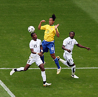 Photo: Chris Ratcliffe.<br /> Brazil v Ghana. Round 2, FIFA World Cup 2006. 27/06/2006.<br /> Ronaldinho of Brazil goes up for a header with John Pantsil (L) and Haminu Draman of Ghana