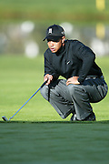 Professional golfer Tiger Woods eyes his line on an upcoming putt in a round two match at the Accenture Match Play Championship World Golf Championships held at the La Costa Resort and Spa on February 27, 2004 in Carlsbad, California. ©Paul Anthony Spinelli