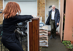 © Licensed to London News Pictures. 03/04/2018. London, UK. A woman (L), who described herself as a life long friend of Labour Party leader, Jeremy Corbyn, holds open the gate as he leaves home. Mr Corbyn is under increasing pressure over alleged anti-Semitism in the Labour Party. Photo credit: Peter Macdiarmid/LNP
