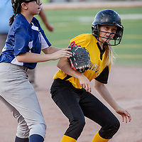 Pirate Graciela SIlva (3) gets picked off first base by Tiger Jaelyn Johnson (8) Tuesday at Ford Canyon Park.