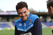 AFC Wimbledon defender Seth Owens (31) (wearing wrong training top number) makes his first full league debut prior the EFL Sky Bet League 1 match between AFC Wimbledon and Bury at the Cherry Red Records Stadium, Kingston, England on 19 November 2016. Photo by Stuart Butcher.