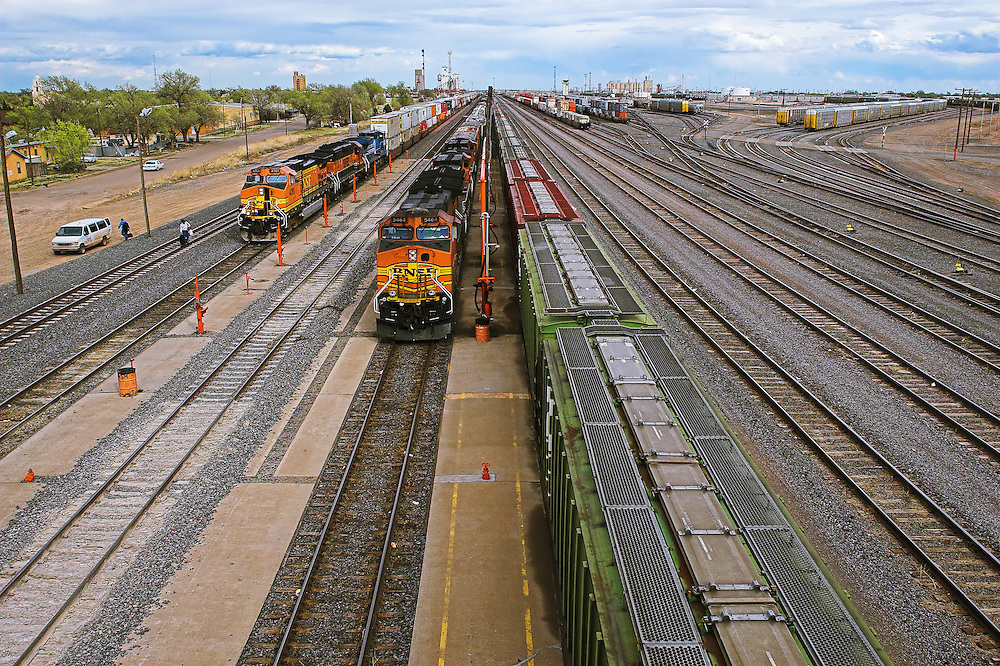 Two westbound BNSF trains sit in the fuel racks at Clovis, NM waiting for new crews to take them towards Los Angeles. This small town in eastern New Mexico is an important division point to the large BNSF Railway.