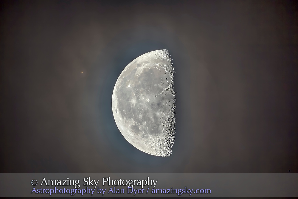The bright star Aldebaran about to be occulted by the waning gibbous Moon on the morning of September 12, 2017. The Moon is amid some high cirrus cloud, adding the coloured glow around the Moon. <br />