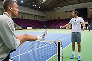 (L) Michal Przysiezny and (R) Jerzy Janowicz both from Poland warm up before training session four days before the BNP Paribas Davis Cup 2014 between Poland and Croatia at Torwar Hall in Warsaw on March 31, 2014.<br /> <br /> Poland, Warsaw, March 31, 2014<br /> <br /> Picture also available in RAW (NEF) or TIFF format on special request.<br /> <br /> For editorial use only. Any commercial or promotional use requires permission.<br /> <br /> Photo by &copy; Adam Nurkiewicz / Mediasport