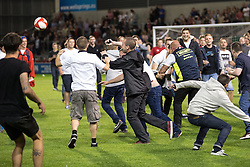 Image ©Licensed to i-Images Picture Agency. 07/08/2014. Salford, United Kingdom. Class of 92 Manchester. AJ Bell Stadium. Pitch invaders after the final whistle try to play their own match . Class of 92 squad play Salford City FC at the AJ Bell Stadium . Picture by i-Images