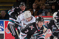 KELOWNA, CANADA - FEBRUARY 16: Braden Purtill #18 of Red Deer Rebels looks for the pass behind Riley Stadel #3 of Kelowna Rockets on February 16, 2016 at Prospera Place in Kelowna, British Columbia, Canada.  (Photo by Marissa Baecker/Shoot the Breeze)  *** Local Caption ***Braden Purtill; Riley Stadel; Jonathan Smart;