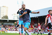 Sheffield Wednesday Forward Atdhe Nuhiu celebrates the opening goal during the Sky Bet Championship match between Brentford and Sheffield Wednesday at Griffin Park, London, England on 26 September 2015. Photo by Phil Duncan.
