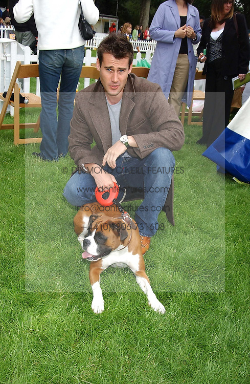 TIM VINCENT and his dog Ruby at the 3rd annual Macmillan Dog Day in aid of Macmillan Cancer Relief held at Royal Hospital Chelsea, London SW3 on 5th July 2005.<br />
