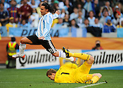 CAPE TOWN, SOUTH AFRICA- Saturday 3 July 2010, Manuel Neuer grabs the ball with Carlos Tevez jumping over him during the quarter final match between Argentina and Germany held at the Cape Town Stadium in Green Point during the 2010 FIFA World Cup..Photo by Roger Sedres/Image SA