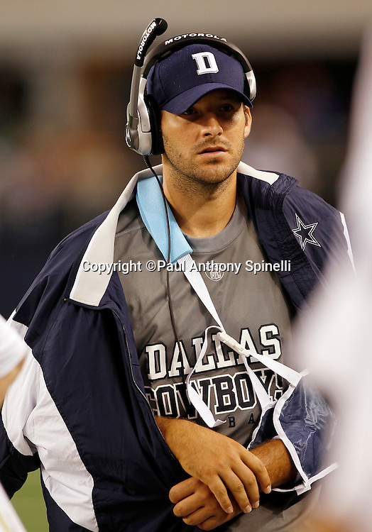 Dallas Cowboys quarterback Tony Romo (9) walks the bench area wearing street clothes and an arm sling after incurring a broken clavicle on a hit by a defensive player during the NFL week 7 football game against the New York Giants on Monday, October 25, 2010 in Arlington, Texas. The Giants won the game 41-35. (©Paul Anthony Spinelli)