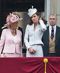 © London News Pictures.. 14/06/2014.  L to R Camilla Duchess of Cornwall and Catherine Duchess of Cambridge on the balcony of Buckingham Palace during the annual Trooping the Colour Ceremony in central London. The event marks the queens official birthday. . Photo credit:Ben Cawthra/LNP