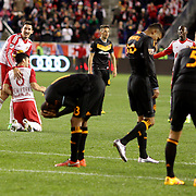 Dejected Houston Dynamo players as Sacha Kljestan congratulates team mate Felipe Martins, New York Red Bulls, who's two spectacular goal earned New York Red Bulls a 4-3 win during the New York Red Bulls Vs Houston Dynamo, Major League Soccer regular season match at Red Bull Arena, Harrison, New Jersey. USA. 19th March 2016. Photo Tim Clayton