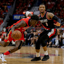 Apr 21, 2018; New Orleans, LA, USA; New Orleans Pelicans guard Jrue Holiday (11) drives past Portland Trail Blazers guard Damian Lillard (0) during the second half in game four of the first round of the 2018 NBA Playoffs at the Smoothie King Center. Mandatory Credit: Derick E. Hingle-USA TODAY Sports
