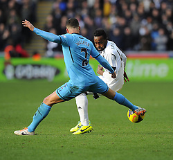 Tottenham Hotspur's Kyle Walker battles for the ball with Swansea City's Roland Lamah - Photo mandatory by-line: Joe Meredith/JMP - Tel: Mobile: 07966 386802 19/01/2014 - SPORT - FOOTBALL - Liberty Stadium - Swansea - Swansea City v Tottenham Hotspur - Barclays Premier League