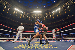 © Licensed to London News Pictures. London, UK  07/10/2011. JOEL KIRBY, Royal Navy (Left) Vs DAVIS FEARBER, US Naval Academy (Right).  Members of the UK and US Armed Forces go head to head in the Royal Albert Hall cup boxing match. This is the first time a boxing event has taken place in the historic venue following a court ruling banning the use of the hall for boxing and wrestling in 1999. The Court of Appeal subsequently overturned the decision earlier this year. The venue has hosted some of the greatest names in British boxing including Sir Henry Cooper, Frank Bruno, Lennox Lewis and Prince Naseem Hamed. Photo credit: Ben Cawthra/LNP