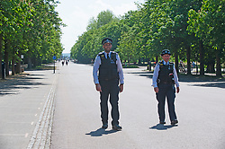 ©Licensed to London News Pictures 21/05/2020<br /> Greenwich, UK. Police officers on patrol in the park. People out and about in Greenwich park, Greenwich, London this afternoon enjoying lockdown freedom as the mini heatwave hot weather continues with temperatures set to hit 28C in parts of the UK.  Photo credit: Grant Falvey/LNP