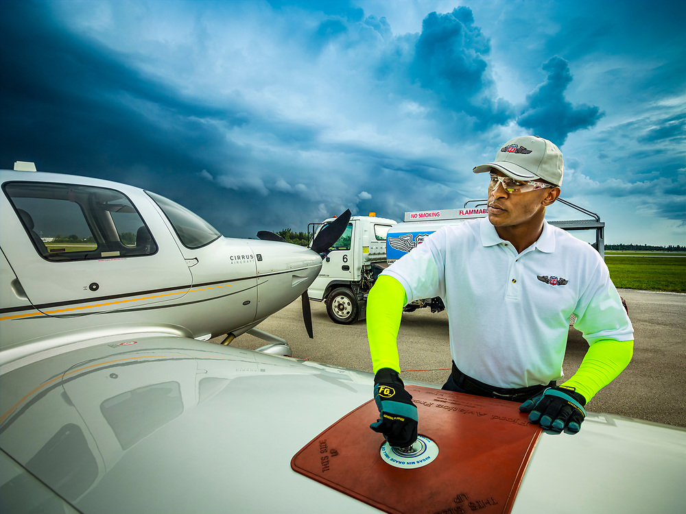 Fueling an aircraft at Opa-locka Executive Airport. Created as advertising for Phillips 66 Aviation Fuels.