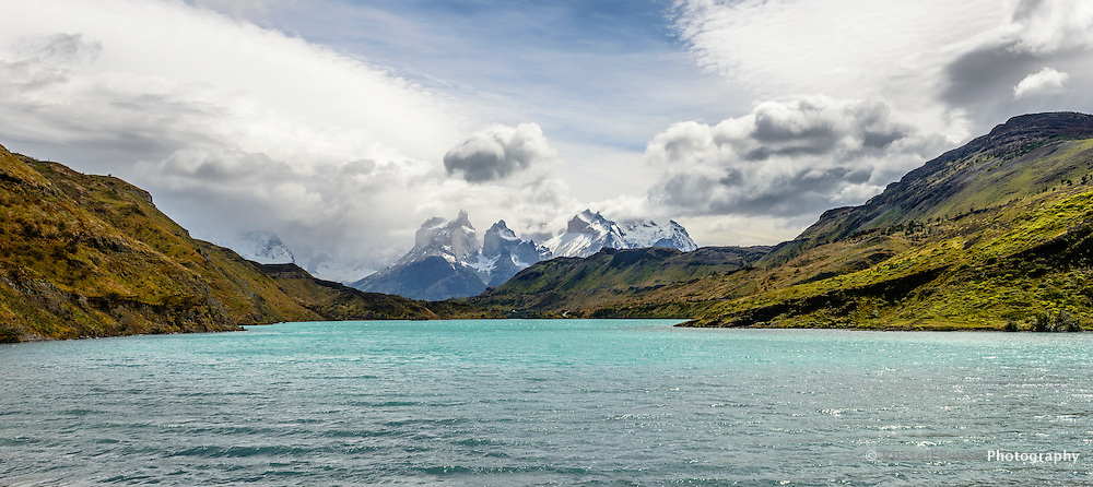 The Cordillera del Paine rises from the landscape with the Rio Paine flowing past - Torres del Paine National Park, Chile.