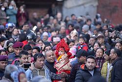 January 2, 2018 - Kathmandu, Nepal - Nepalese devotees carrying Trishna Shakya, 3yrs old Kumari or living goddess back towards Kumari Ghar or Home through destructed heritage monuments after observing the Changu Narayan festival celebrated at Hunuman Dhoka, Kathmandu, Nepal on Tuesday, January 02, 2018. (Credit Image: © Narayan Maharjan/NurPhoto via ZUMA Press)