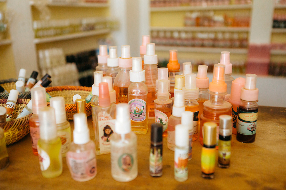 KELAAT M'GOUNA, MOROCCO - 14TH MAY 2016 -  Rose Water and Oil cosmetic beauty products for sale at a local shop.