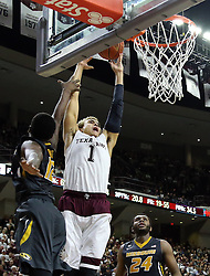 Texas A&M's D.J. Hogg (1) is fouled by Missouri's Namon Wright (12) during the second half of an NCAA college basketball game, Saturday, Jan. 23, 2016, in College Station, Texas.  Texas A&M won 66-53.  (AP Photo/Sam Craft)