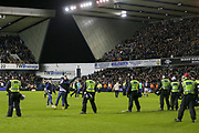 Millwall fans invade the pitch after winning with Police during the The FA Cup fourth round match between Millwall and Everton at The Den, London, England on 26 January 2019.