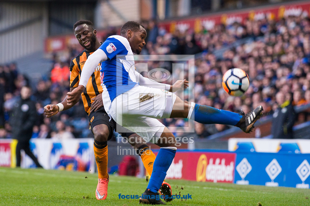Ryan Nyambe of Blackburn Rovers with a clearance ahead of Adama Diomande of Hull City during the FA Cup match at Ewood Park, Blackburn<br /> Picture by Matt Wilkinson/Focus Images Ltd 07814 960751<br /> 06/01/2018