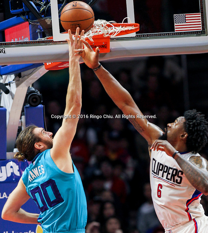 Charlotte Hornets Spencer Hawes goes up against Los Angeles Clippers DeAndre Jordan during the NBA basketball game against Charlotte Hornets in Los Angeles, the United States, Jan. 9, 2016. Los Angeles Clippers won 97-83. (Xinhua/Zhao Hanrong)(Photo by Ringo Chiu/PHOTOFORMULA.com)<br /> <br /> Usage Notes: This content is intended for editorial use only. For other uses, additional clearances may be required.