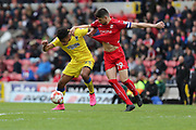 AFC Wimbledon striker Lyle Taylor (33) and Swindon Town defender Raphael Rossi Branco (29) during the EFL Sky Bet League 1 match between Swindon Town and AFC Wimbledon at the County Ground, Swindon, England on 14 April 2017. Photo by Stuart Butcher.