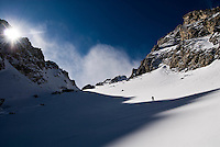 A young man skins through Shadow Peak Cirque in Grand Teton National Park, Jackson Hole, Wyoming.