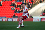 Doncaster Rovers Midfielder Tommy Rowe (10) gets the ball under control as Scunthorpe United goalkeeper Matthew Gilks (1) kicks the ball at him during the The FA Cup match between Doncaster Rovers and Scunthorpe United at the Keepmoat Stadium, Doncaster, England on 3 December 2017. Photo by Craig Zadoroznyj.