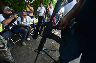 Self defense forces meet in a tiny settlement called Division del Norte. The self-defense groups had been battling the notorious Knights Templar drug gang in their own towns but are increasingly well-coordinated and well-armed.