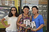 Huntington, New York, U.S. -  August 6, 2014 - L-R, SAYARA PRADHAM, ANGELA PRADHAM, and their mother NEELIMA PRADHAN, of Huntington, are waiting on line to attend the book signing for H. Clinton's new memoir, Hard Choices, at the Book Revue in Huntington, Long Island. Clinton's book is about her four years as America's 67th Secretary of State and how they influence her view of the future.