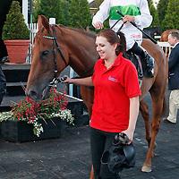 Ostentation and Leonna Mayor winning the 8.30 race