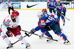 Andrej Hebar of Slovenia vs Oleg Goroshko of Belarus during ice-hockey match between Slovenia and Belarus of Group G in Relegation Round of IIHF 2011 World Championship Slovakia, on May 8, 2011 in Orange Arena, Bratislava, Slovakia. (Photo by Matic Klansek Velej / Sportida)