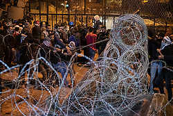 © Licensed to London News Pictures. 25/01/2020. Beirut, Lebanon. Demonstrators pull down a newly erected fence on Riad Al Solh Square, Beirut, outside the Grand Serail (Government Palace), where it is reported that Lebanese Prime Minister Hassan Diab is living. Today marks the 100th day of demonstrations in Lebanon. Police used tear gas and water cannon to disperse the anti-government demonstrators, who are campaigning against government corruption and economic crisis. Photo credit : Tom Nicholson/LNP