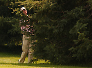 2007 Boyne Tournament of Champions winner Michael Harris of Troy watches his second shot from behind a pine tree on the par 5 18th of Boyne Mountains Alpine course.