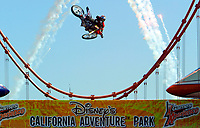 Jul 01, 2003; Anaheim, California, USA; Moto X star athlete MIKE METZGER executing a tremendous stunt with a full sized motobike over the Park's replica of the Golden Gate Bride for the opening of Disney's California Adventure &quot;X Games Experience&quot;.  Disney park has built two X-Arena's specifically for this 41 day event highlighting extreme sports for the launch of the 2003 ESPN X Games.<br />