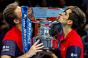 Nicolas Mahut of France (left) and doubles partner Pierre-Hugues Herbert kiss their winners trophy during the Nitto ATP finals at the O2 Arena, London, United Kingdom on 17 November 2019.